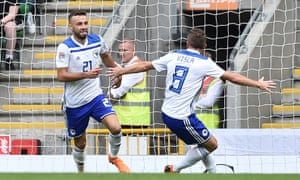 Elvis Saric, left, celebrates his goal, which proved to be the winner for Bosnia-Herzegovina.