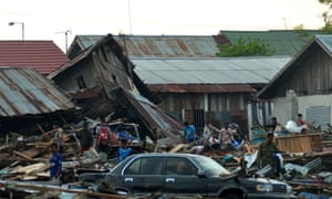 Residents trying to salvage belongings from their homes which collapsed after an earthquake and tsunami hit Palu on Sulawesi island.
