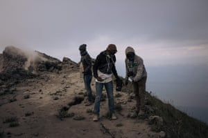 Volcanologists take temperature readings