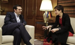 Greek Prime Minister Alexis Tsipras, left, meets with German politician and Member of the European Parliament for The Greens Ska Keller, in Athens, on Friday, Feb. 27, 2015. Greece was granted the extension by its European creditors last week in exchange for a commitment to budget reforms.(AP Photo/Petros Giannakouris)