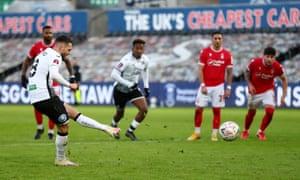 Matt Grimes scores the penalty for the Swan's third goal.