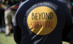 T-shirt at a protest reading: From Surviving the Thriving. Beyond Survival.