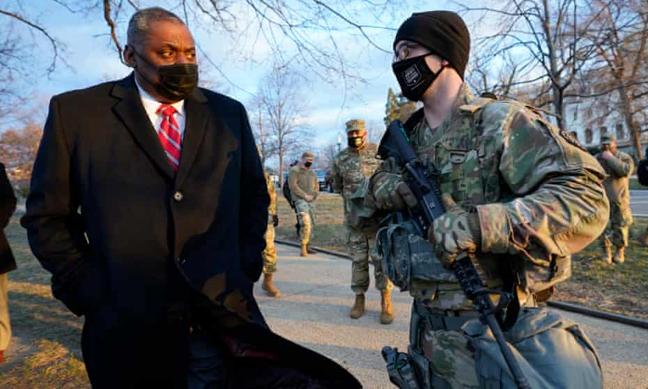 The US defense secretary, Lloyd Austin, visits national guard troops deployed at the US Capitol on 29 January.