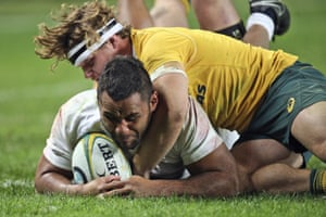 Billy Vunipola of England holds off Michael Hooper to score their third try.