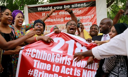 Campaigners in Abuja react to the rescue of a teenager in May, meaning 218 rather 219 schoolgirls were still missing.