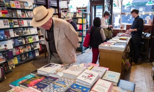 A customer examines the hardbacks in Daunt Books, central London