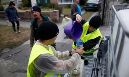 Volunteers distribute clean water to residents following the Christchurch earthquake.