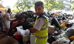 British Red Cross volunteer with Grenfell Tower donations