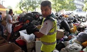 A British Red Cross volunteer sorts articles of food, clothing, toys and household items donated in the wake of the Grenfell Tower fire.