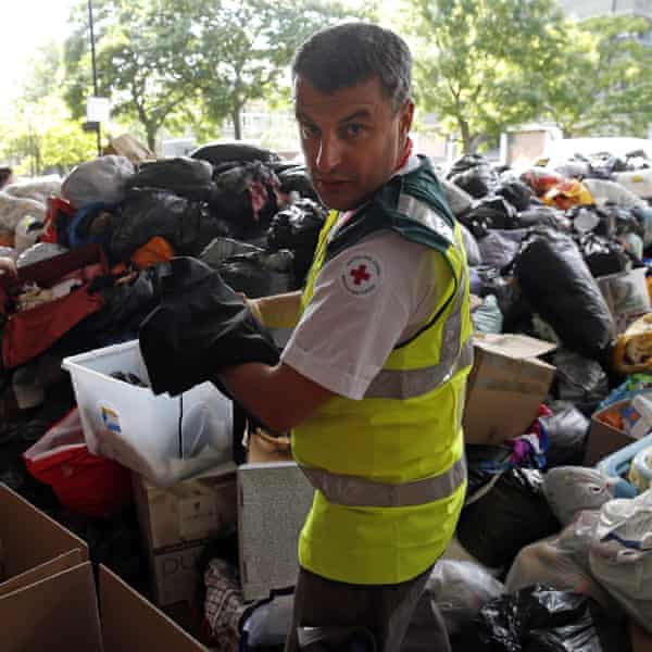 A British Red Cross volunteer sorting donations after the Grenfell Tower fire in June 2017.
