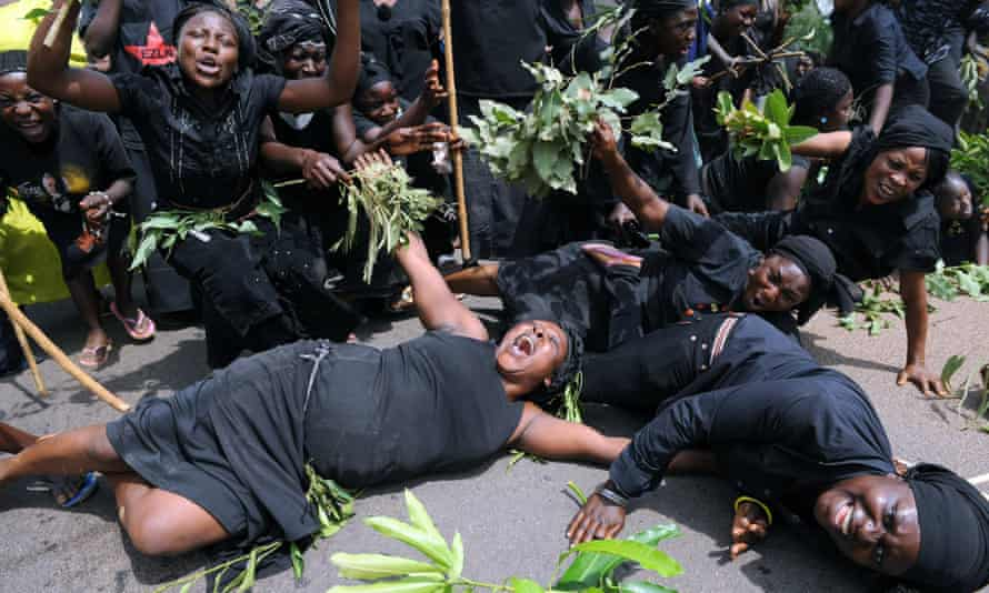 Women mourn after Fulani herdsmen attack the village of Jos in Nigeria's south.
