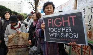 Supporters of Shiori Ito hold up signs in front of the Tokyo district court on Wednesday.