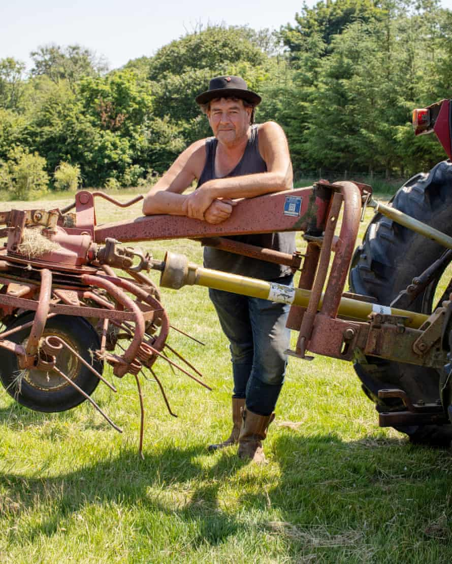 Daniel Colbourne, who plants crops and runs a duck farm with Rachel Stevens, poses in his field and land close to Fishguard, West Wales.