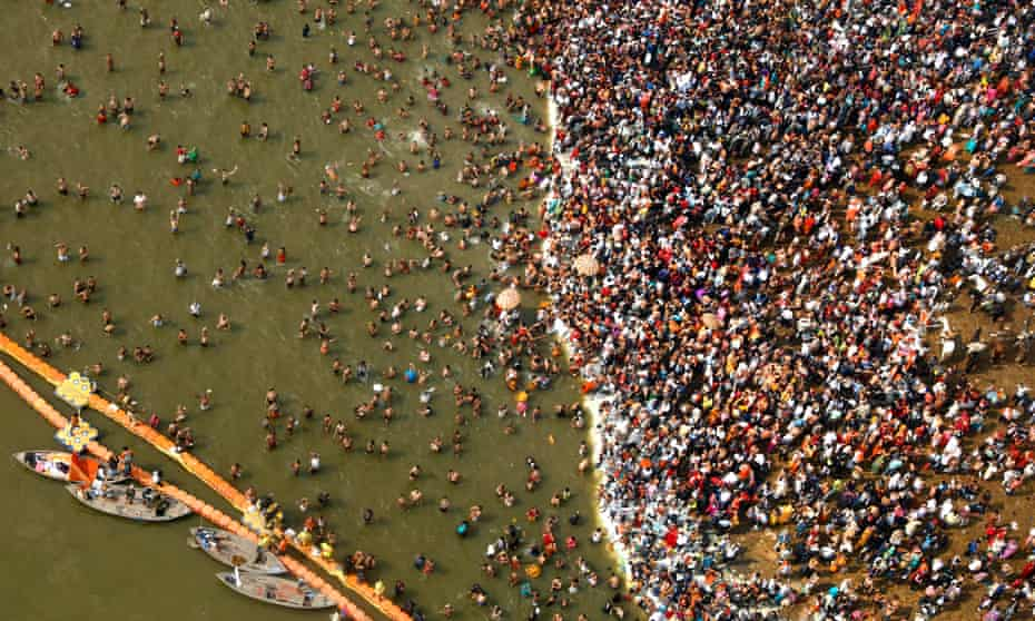 Hindu devotees take dips at Sangam, the confluence of the Yamuna and the Ganges rivers, on Mauni Amavsya, the most auspicious day of Kumbh Mela.