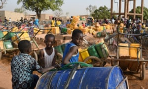 Children wait for their turn to buy water in Ouagadougou, Burkina Faso