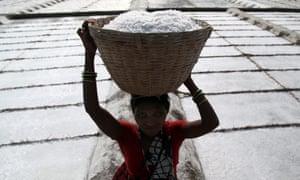 Woman working at a salt pan in Mumbai