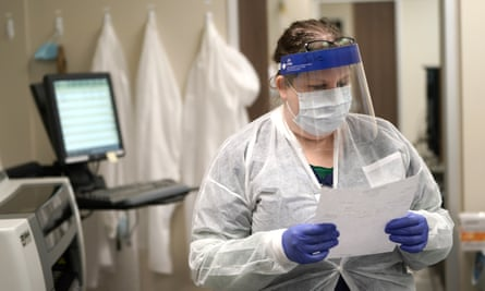 A medical technologist looks over antibody test results.