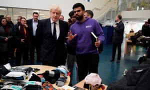 Boris Johnson speaks to staff and students as he visits the University of Bolton after the fire.