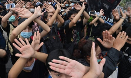 Protesters learn hand gestures and signs to communicate with one another in Bangkok