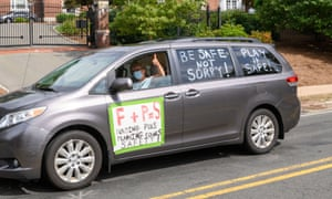 A vehicle participating in the 'School Safety First' car caravan passes the governor's Ned Lamont's home in Hartford Connecticut.