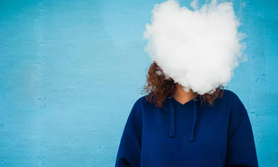 A woman vaping behind a cloud of vaprou