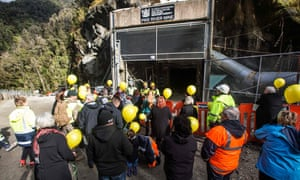 Victims' families prepare to release 29 yellow balloons at the entrance to the Pike river mine.