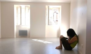 A sad woman in an empty room