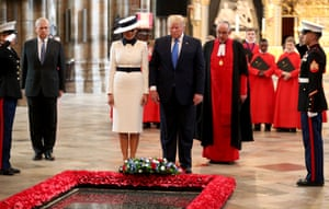 President Trump and First Lady Melania Trump stand in silence after laying a wreath at the Grave of the Unknown Warrior during their visit to Westminster Abbey
