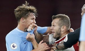 Arsenal Under 23 v Manchester City Under 23, FA Under 23 Premier League, Football, Emirates Stadium, London, UK - 21/08/2017<br>Mandatory Credit: Photo by Matthew Impey/REX/Shutterstock (9011463r) Jack Wilshere of Arsenal wrestles with Tyreke Wilson of Manchester City shortly before being sent off for pushing over Matthew Smith of Manchester City Arsenal Under 23 v Manchester City Under 23, FA Under 23 Premier League, Football, Emirates Stadium, London, UK - 21/08/2017