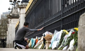 View of Buckingham Palace a day after Prince Philip died, in LondonA mourner kneels down outside Buckingham Palace after Britain's Prince Philip, husband of Queen Elizabeth, died at the age of 99, in London, Britain, April 10, 2021. REUTERS/Henry Nicholls