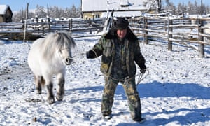 'The school only closes when it goes below -52C outside': horse breeder Mikhail Etigelow.