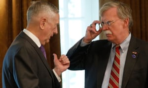 Jim Mattis talks with John Bolton in the Cabinet Room at the White House.