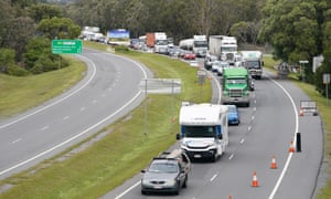 Motorists approaching a checkpoint at Coolangatta on the Queensland-New South Wales border, Friday, 7 August, 2020.