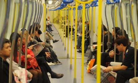 Passengers on a Hong Kong metro train. The MTR is one of the few public transport operators to make a profit.