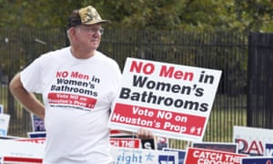 A man urges people to vote against the Houston Equal Rights Ordinance outside an early voting center in Houston in October.
