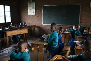 Children attend class at the Nyabitsinde primary school near the Volcanoes national park in Kinigi, Rwanda.