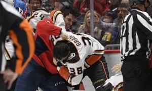 Garnet Hathaway fights Anaheim Ducks center Derek Grant during Monday night's game