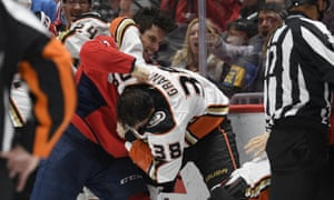Garnet Hathaway (21) fights Anaheim Ducks center Derek Grant (38) during the second period of Monday's game