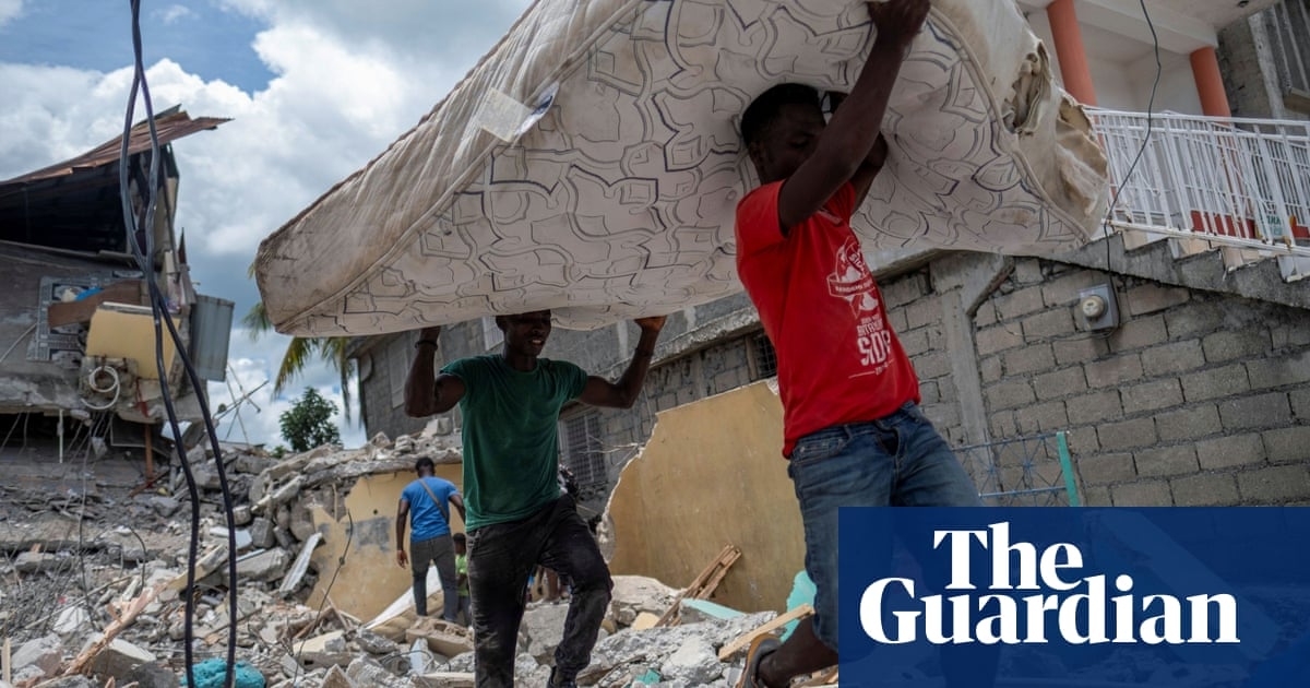 'We have no place to go': Haiti earthquake shelters exposed to tropical storm – video report