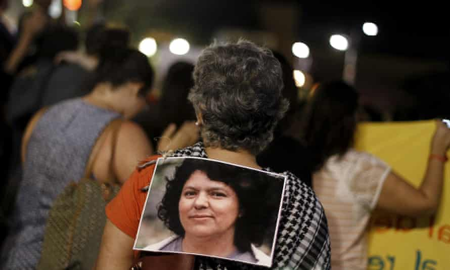 An activist carries a photo of Berta Cáceres during a protest to mark International Women's Day in San Jose, Costa Rica on 8 March, 2016.
