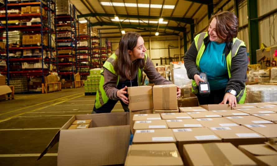 Jenny Carlyle (left) and Isis Carrasco scanning boxes in the Suma warehouse