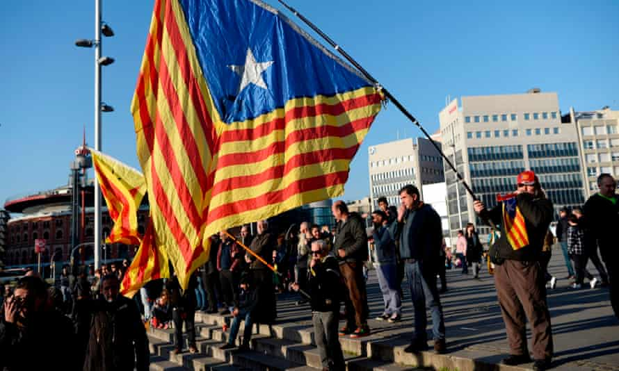 Pro-independence Catalan flags are waved during a protest against Spanish king Felipe VI's visit to the Mobile World Congress on 24 February.