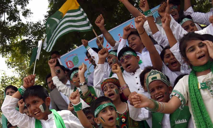 Pakistani school children take part in a protest in Karachi against India's policies in Kashmir