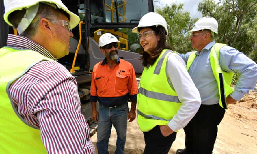 Queensland premier Annastacia Palaszczuk embraces hi-vis publicity while inspects the construction work of Riverway Drive in Townsville on Monday.