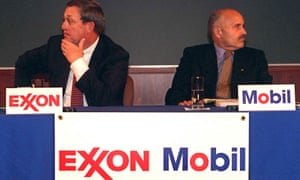 Lee Raymond, chairman of Exxon Corp., left, and Lucio Noto, chairman of Mobil Corp., look in opposite directions during the news conference to announce the merger of their companies Tuesday, Dec. 1, 1998, in New York .