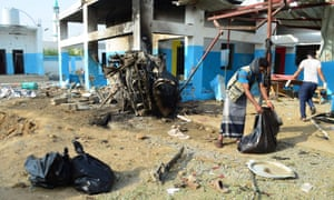 Workers clean up after a hospital operated by MSF in Abs was hit by a Saudi-led airstrike. At least 11 people were killed.