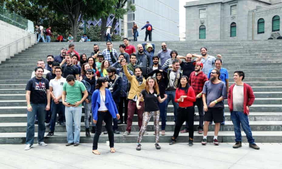 Coders and designers celebrate the end of their 48-hour hackathon at the Centro de Cultura Digital in Mexico City.