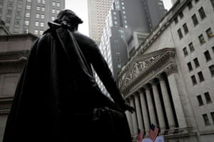 The New York stock exchange, seen from behind the statue of George Washington at Federal Hall