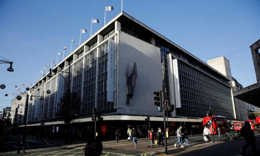 Shoppers walk past the John Lewis department store on Oxford Street in London