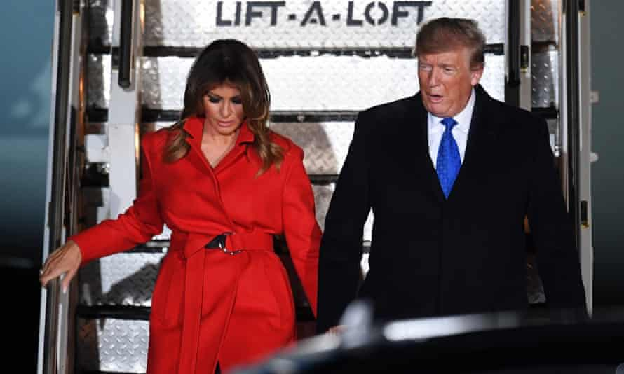 Melania and Donald Trump arrive at Stansted on Monday night.